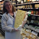 Catherine and a big wedge of cheese